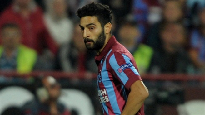 Ten-man Trabzonspor stun Metalist to advance