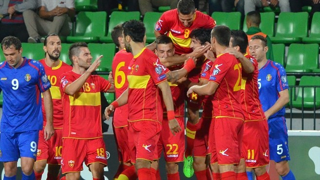 Montenegro triumph to stay in play-off hunt