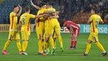 Romania players celebrate
