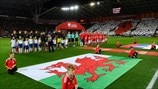 Wales and Serbia players line up