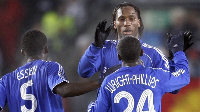 Drogba double fires Chelsea through