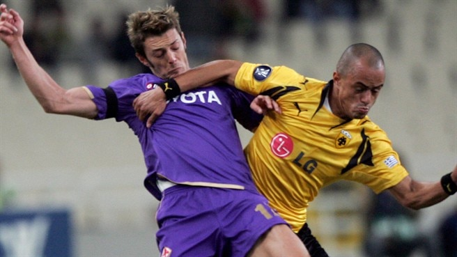 Viola own goal keeps AEK afloat