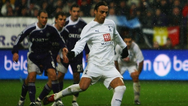 Cool Berbatov aids Tottenham progress