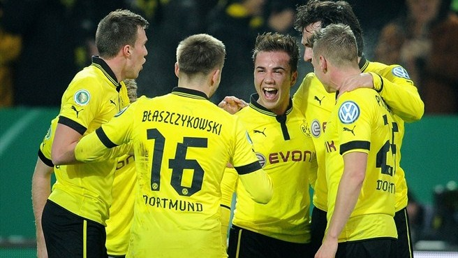 Dortmund march on as Napoli sink