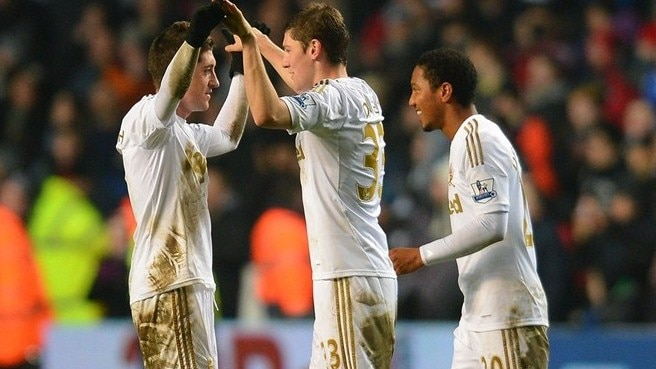 Swansea stop Chelsea to reach first Wembley final