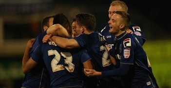 Oldham goalscorer Reece Wabara celebrates with team-mates
