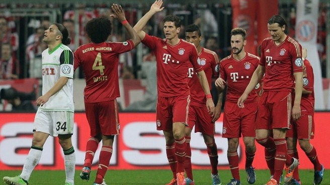 Gomez scores hat-trick as Bayern reach final