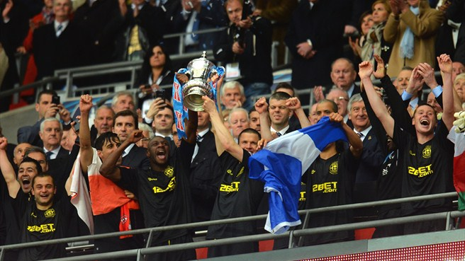 Watson steers Wigan to maiden FA Cup triumph