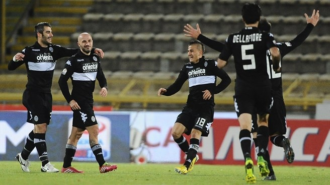 Parma progress as Bologna crash out