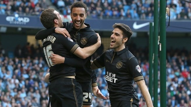 Wigan stun City to book Arsenal showdown