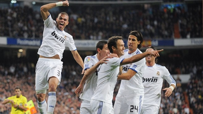 Derby victory keeps Madrid out in front