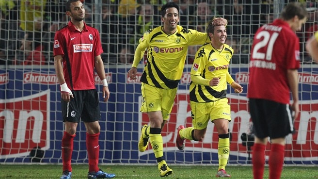 Dortmund and Mainz rally to stay on course