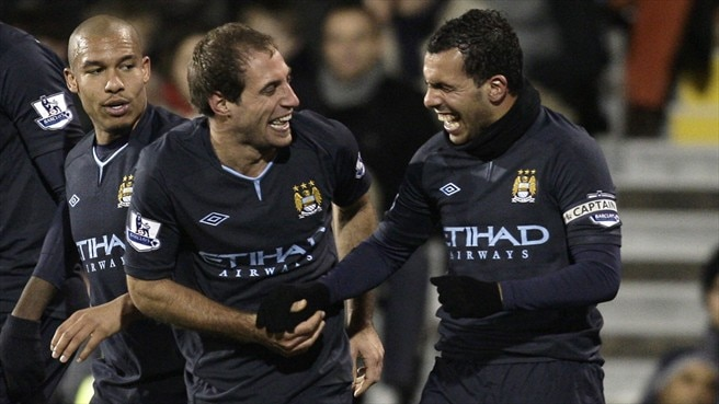 Two-goal Tévez leads City victory charge