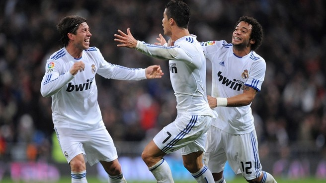 Ronaldo treble rouses Madrid to victory