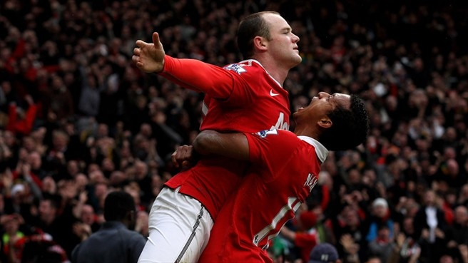 Rooney acrobatics earn United derby spoils
