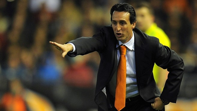 Valencia's Emery aims high after new one-year deal