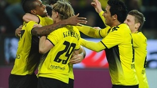 Ruhr derby victory takes Dortmund top