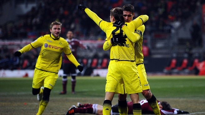 Barrios adds gloss as Dortmund go top