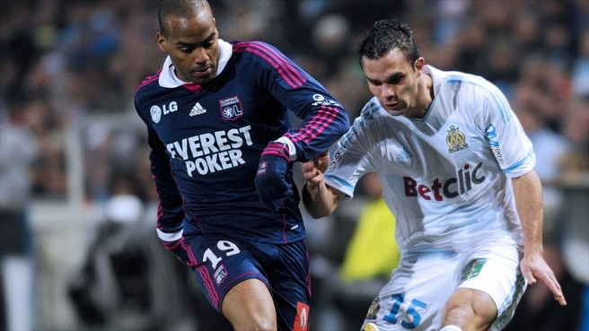 Lyon battle back to hold Marseille