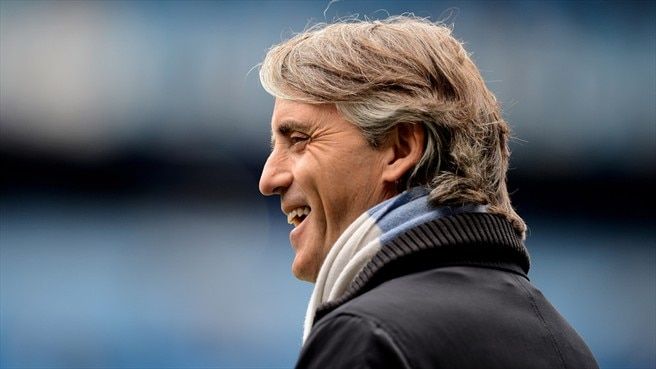 Delighted Mancini pens new City deal
