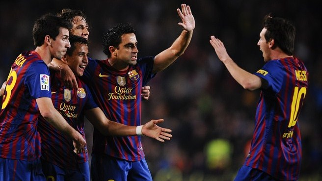 Four-goal Barcelona pile the pressure on Madrid