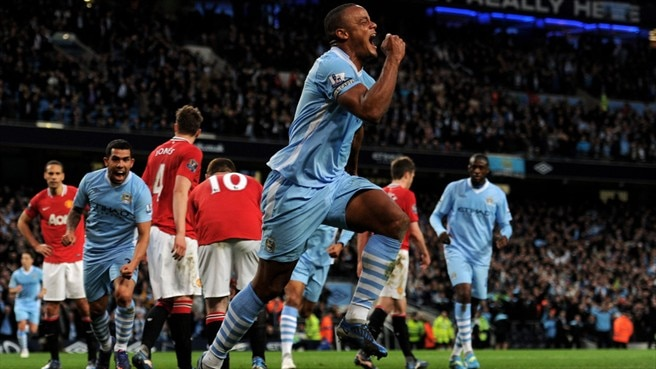 Derby victory takes Manchester City top
