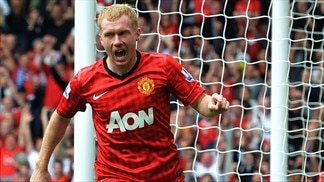 United midfielder Scholes confirms retirement