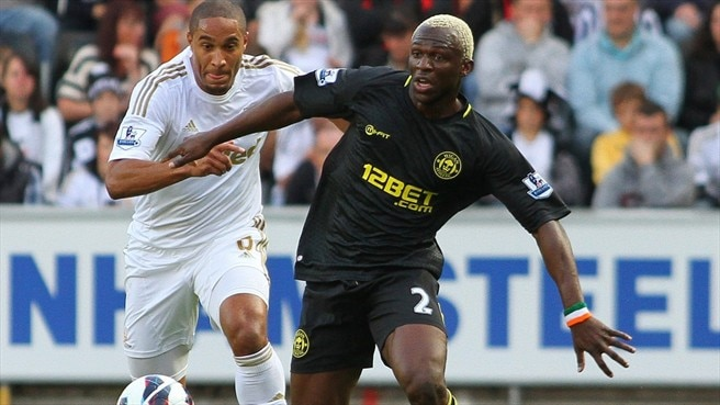 Jonathan De Guzman (Swansea City AFC) & Arouna Koné (Wigan Athletic FC)
