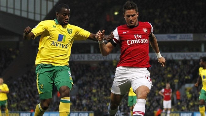 Sébastien Bassong (Norwich City FC) & Olivier Giroud (Arsenal FC)