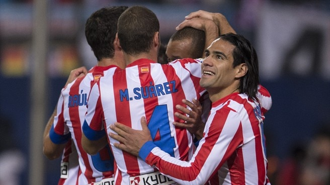 Atlético stay hot on Barcelona's heels