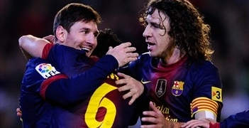 Lionel Messi is congratulated by team-mates after scoring for Barcelona