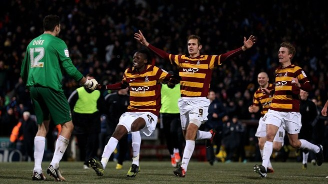 Arsenal knocked out by fourth-division Bradford