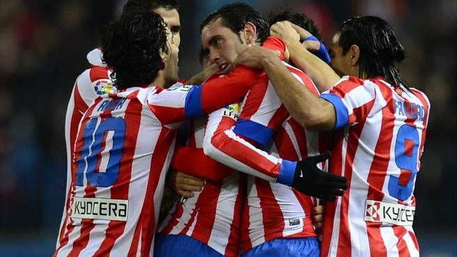 Atlético edge Celta to close gap