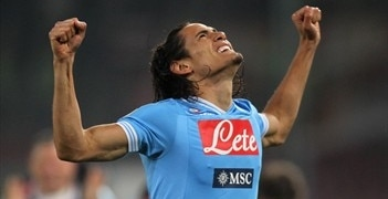 Edinson Cavani celebrates one of his three goals against Roma