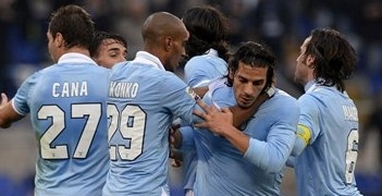 Lazio's players congratulate Sergio Floccari (second right) on his goal against Atalanta
