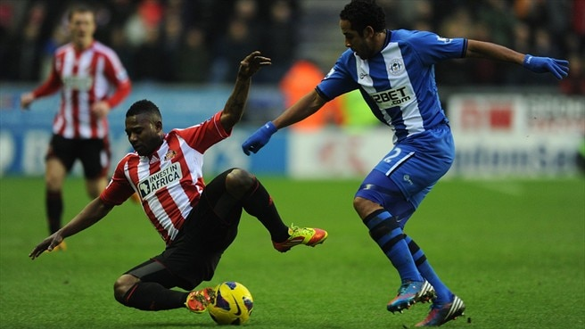 Jean Beausejour (Wigan Athletic FC) & Stephane Sessegnon (Sunderland AFC)