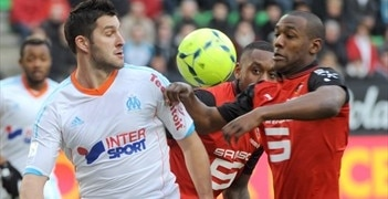Rennes goalscorer Kévin Théophile-Catherine (right) vies with Marseille's André-Pierre Gignac