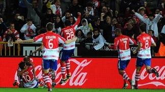 New man Alcaraz helps Granada take Madrid scalp