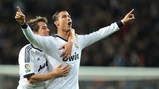 Ronaldo hat-trick helps Madrid close on second