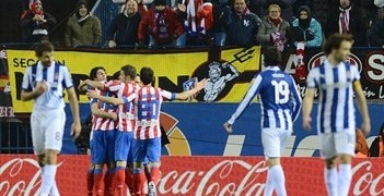 Atlético celebrate Falcao's first-half penalty