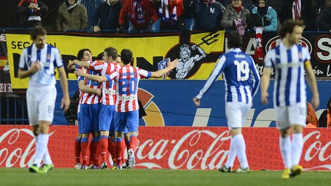 Ten-man Atlético dig deep to sink Espanyol
