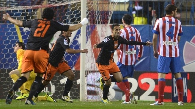 Valencia prevent Atlético going second