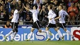 Valencia CF players celebrate a goal