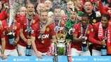 Manchester United FC players celebrate with the trophy