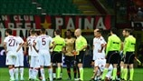 Referee Gianluca Rocchi temporarily suspends the match