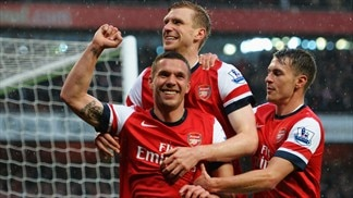 Wigan relegated with Arsenal defeat