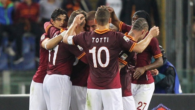 Roma beat Atalanta to stay on Juve's coat-tails