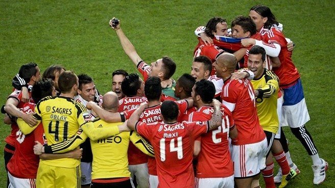 Benfica lift cup to seal historic treble