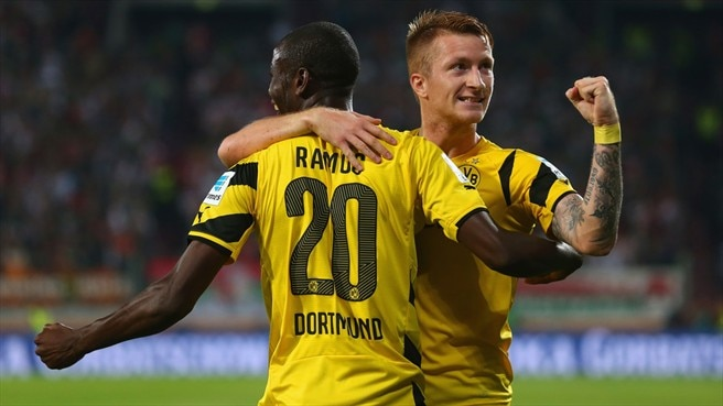 Augsburg give Dortmund late fright