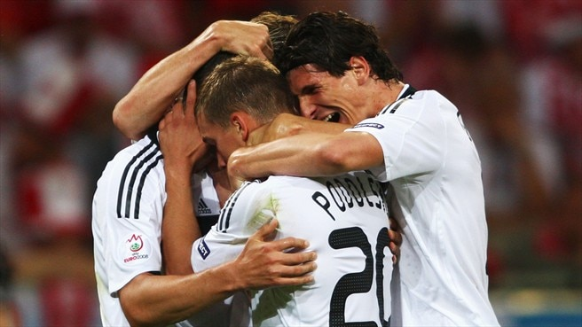 Podolski double gets Germany going